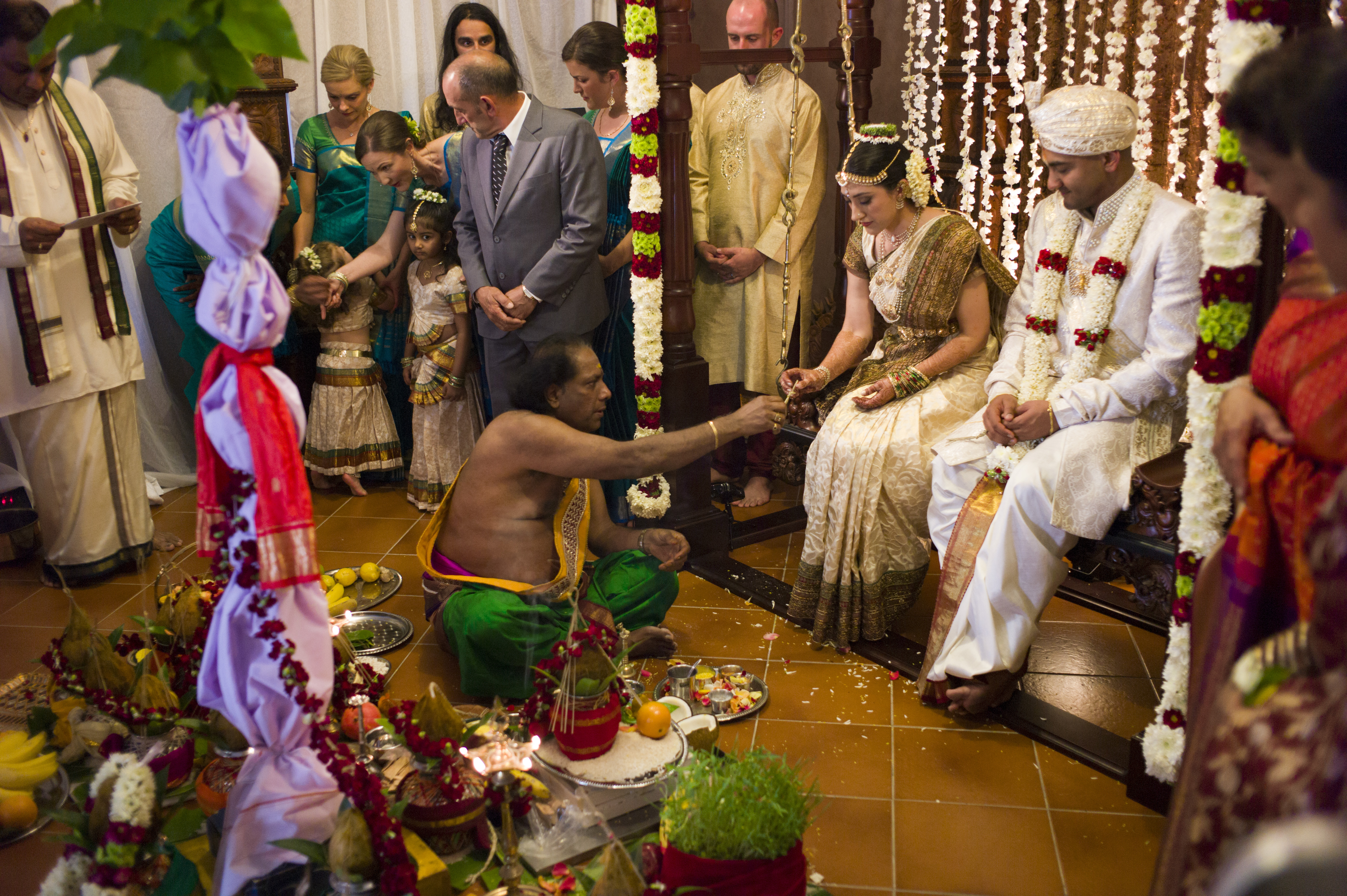 Newly weds sit in festive surrounds from Counting and Cracking