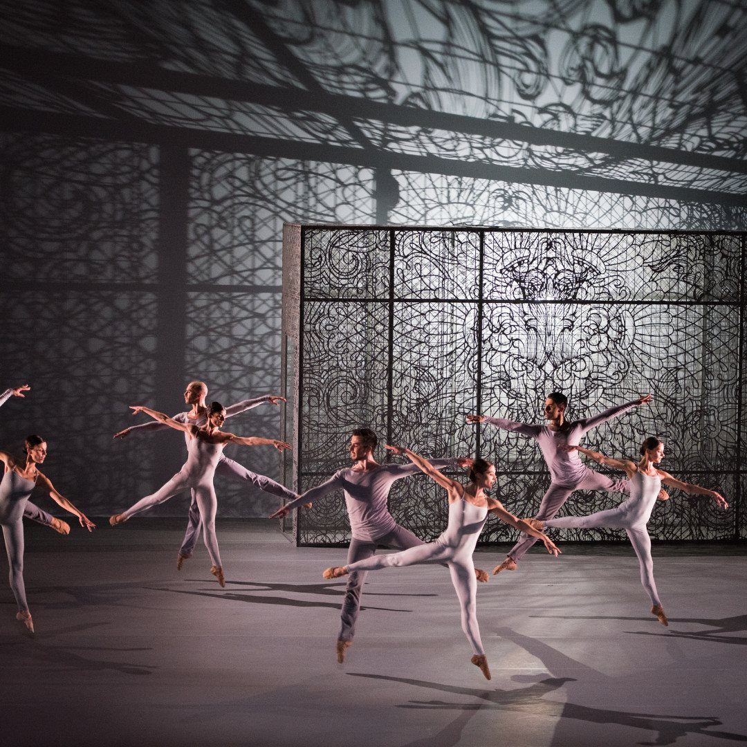 Four ballet dancers in motion
