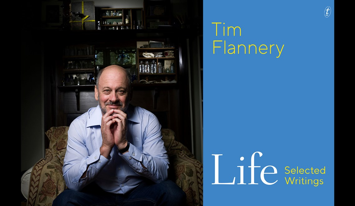 Tim Flannery alongside the cover of his book Life